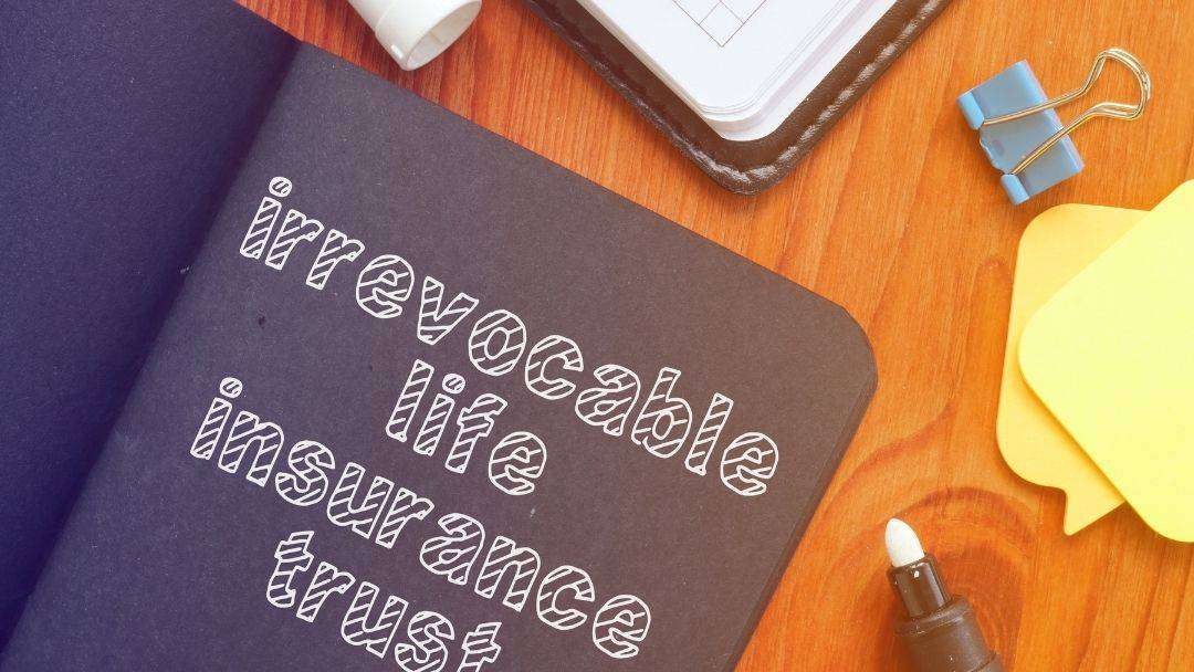 Irrevocable life insurance trusts - decorative image of a book on a desk
